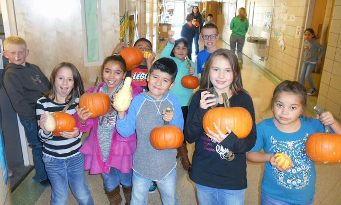 third graders with pumpkins